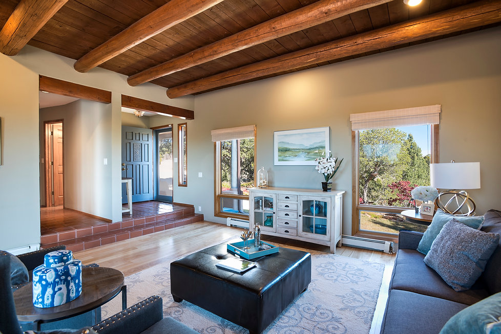 Living room and front entry to lovely Santa Fe living room with desert views.