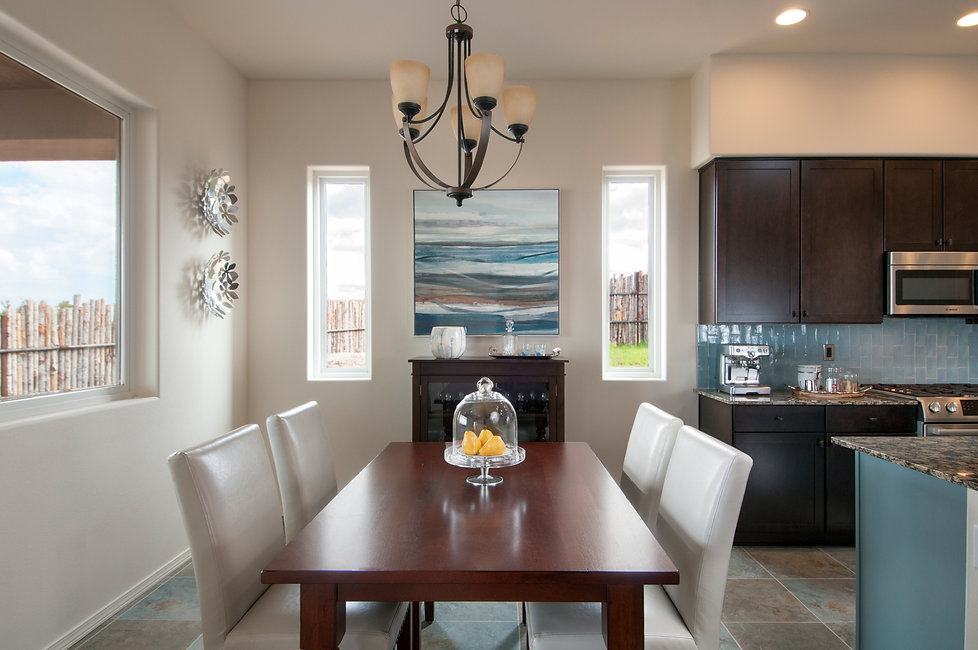 Stylish dining room with rich wood accents and a calming cool color scheme.