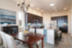Modern kitchen and dining area staged by Debbie DeMarais for Homewise builders in Santa Fe, NM.