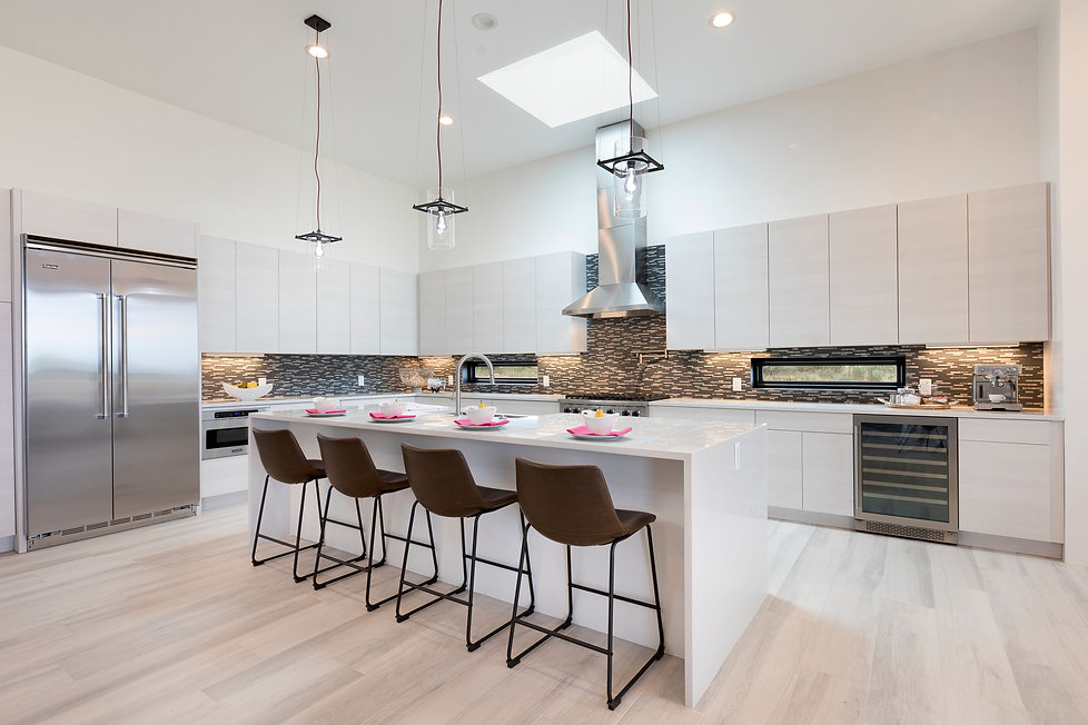 Luxe kitchen styling with floating island and stainless steel appliances.