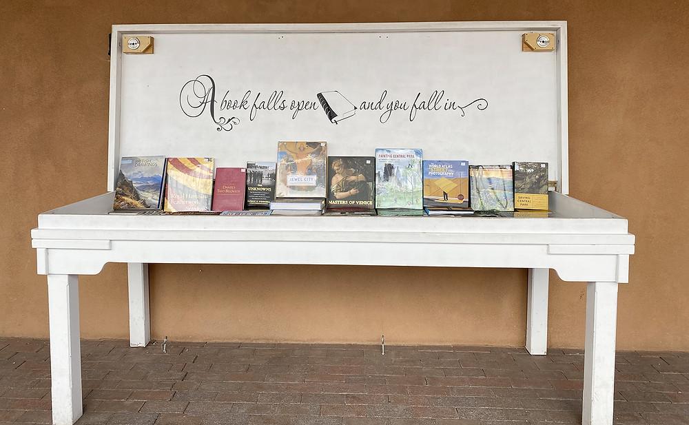 Book display table against adobe wall in Santa Fe, NM