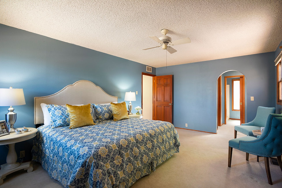 Blue master bedroom styled with matching linens and home decor.