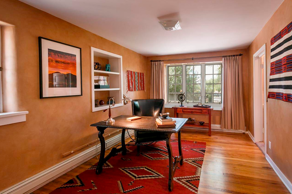 Warm earth tones and bright red decor exude Santa Fe style in this home office.