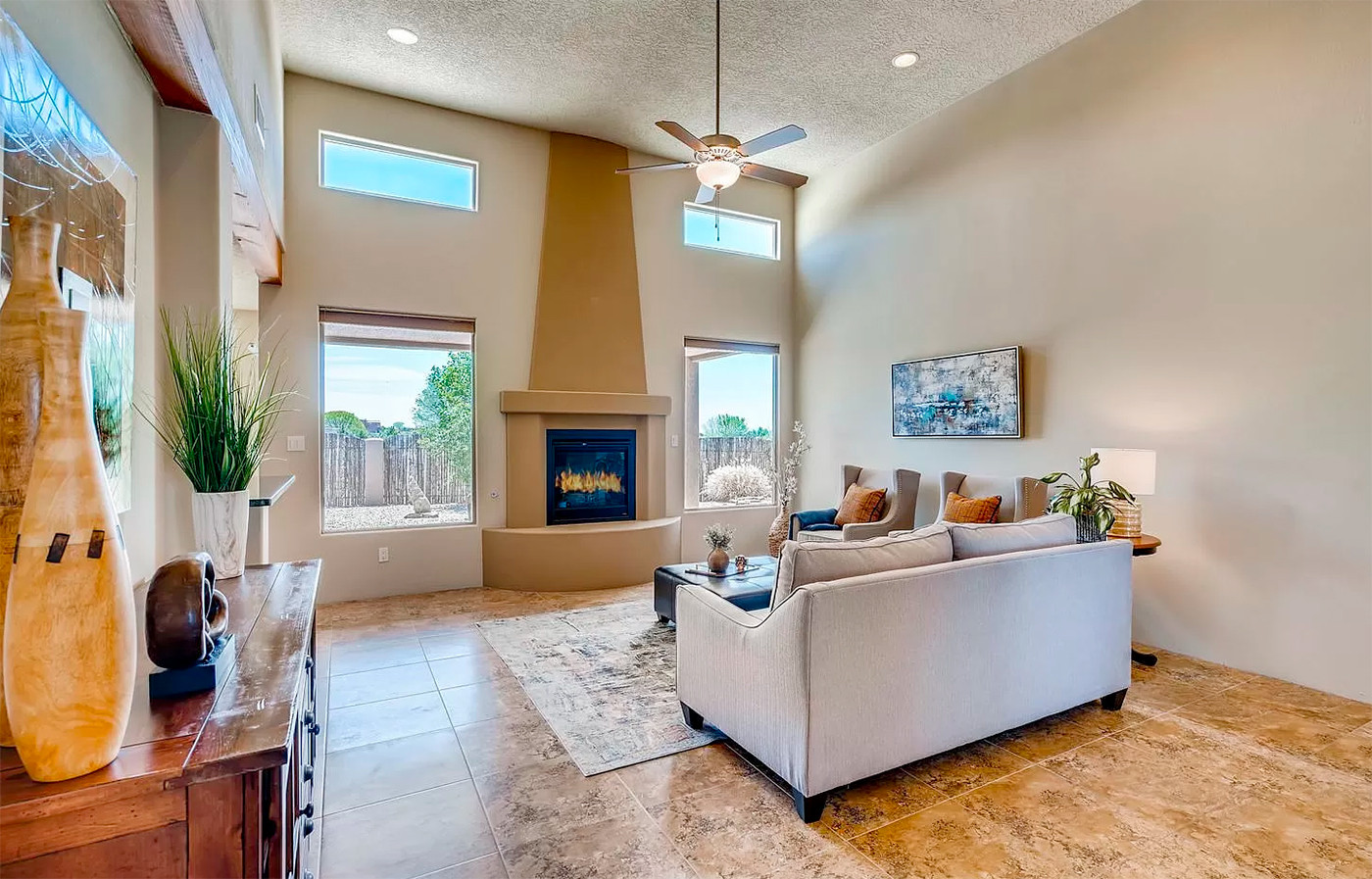 Canto Del Pajaro | Home Staging to Emphasize Cathedral Ceilings and Fireplace