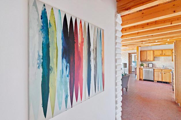 Verano Place | Bright Artwork Provides Drama to White Walls