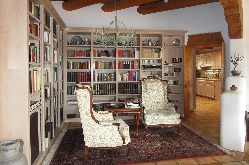 Built-in bookcases in a library alcove at a Santa Fe home