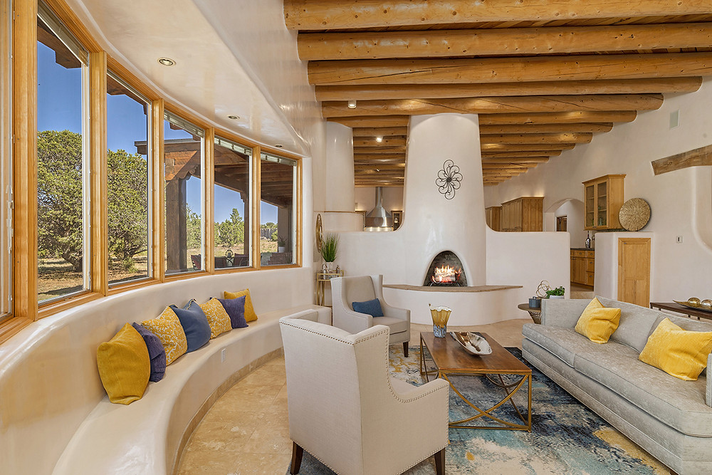 Luxury living room in Santa Fe style home staged with yellow and blue accent colors