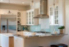 Color tile accent in modern Santa Fe kitchen design.