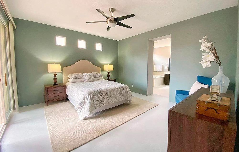 Master bedroom suite with neutral tones and calming blue-green paint color
