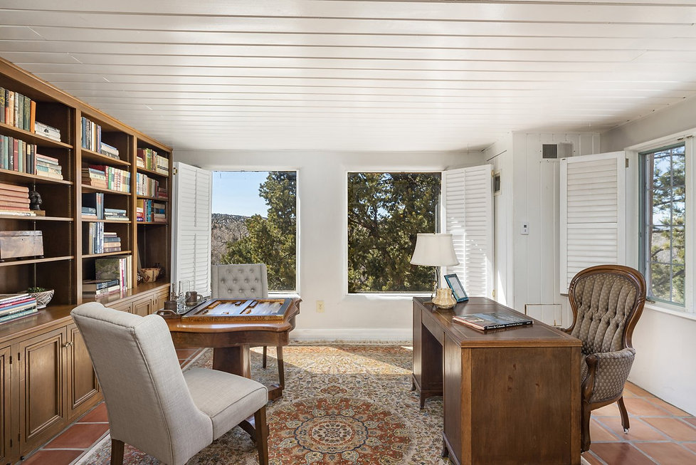 Home office with built-in bookcases and magnificent view.