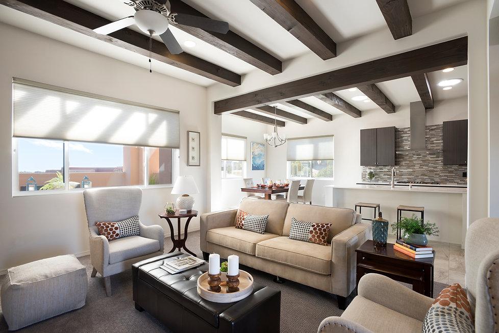 Dark hardwood vigas contrast beautifully with serene white interior of open concept floorplan.