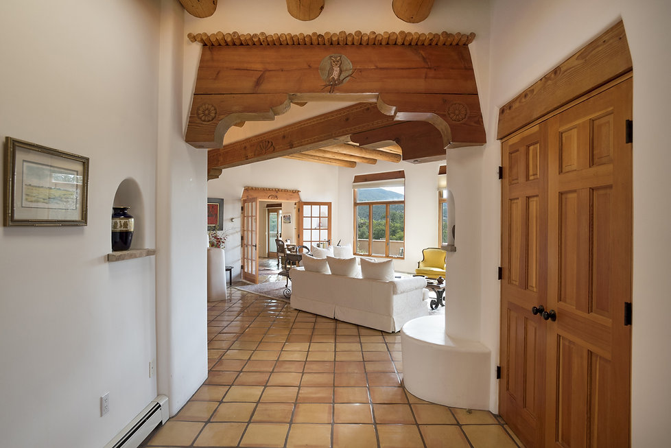 Carved entryway lintel in gorgeous Santa Fe home built by Sonny Otero.