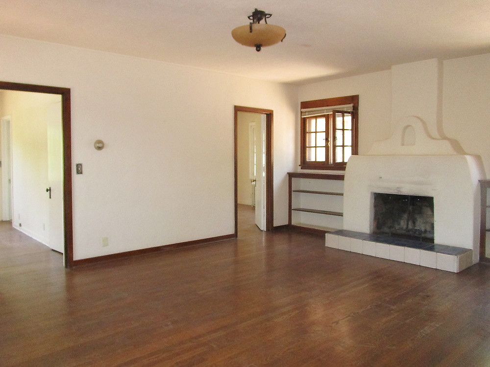 Empty living room in Santa Fe prior to home staging services and professional real estate photography.