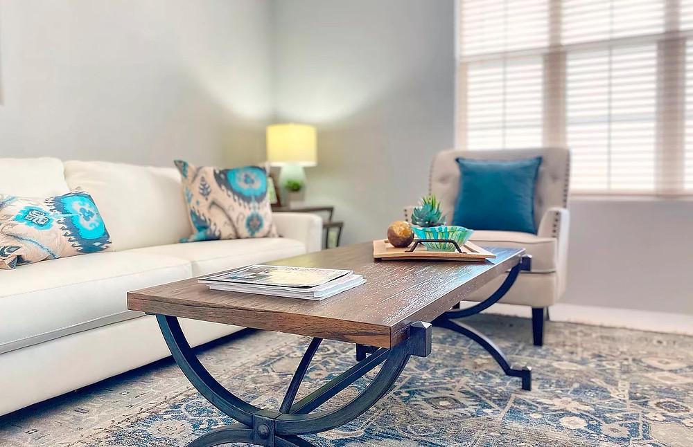 Stylish living room seating arrangement focused on hardwood coffee table