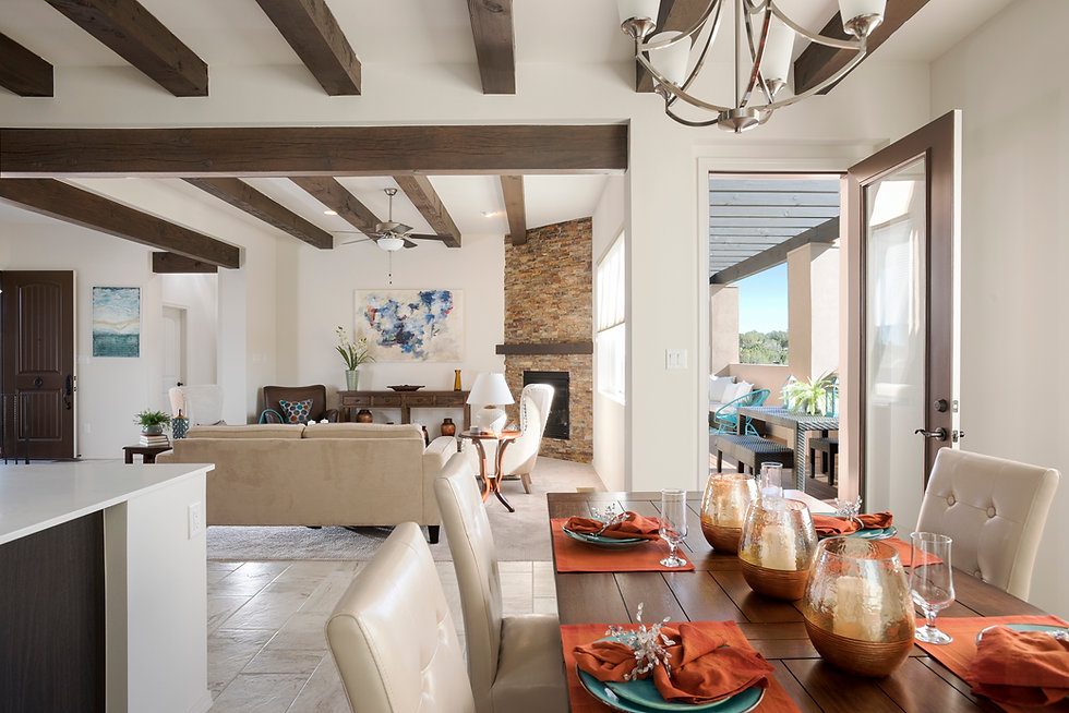 Bold orange table settings add drama to beautiful modern Santa Fe show home.