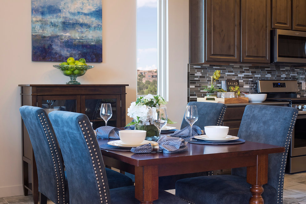 Santa Fe dining room staged in a transitional style that emphasizes modern living.