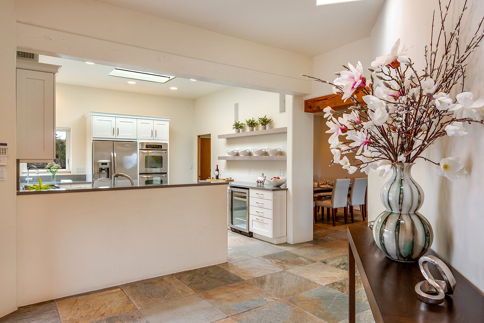 Bright kitchen with skylight and side board in luxury Santa Fe home.
