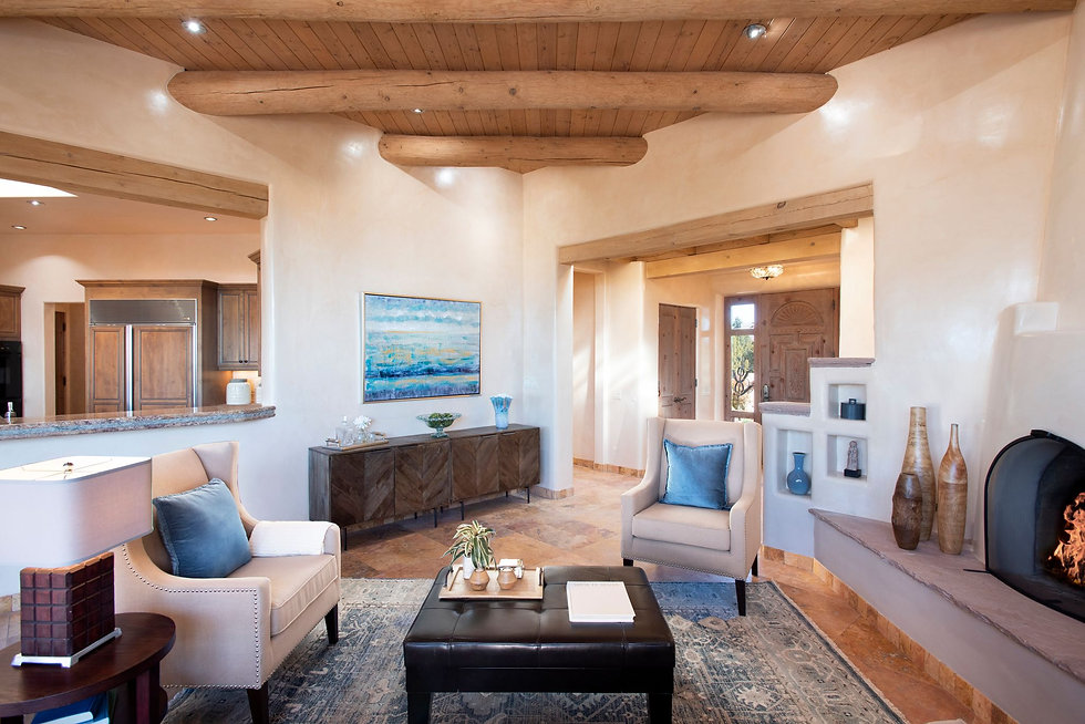 Gorgeous contemporary southwest style living room with kiva fireplace.