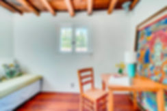 Home staging of traditional adobe home that cleverly incorporates abandoned artwork.