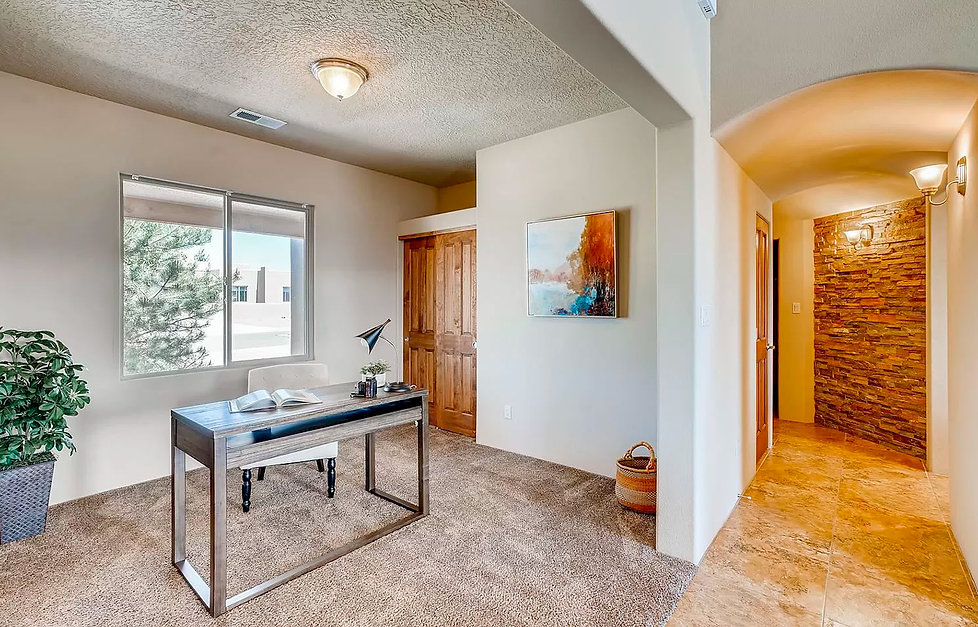 Home office placed in living area bonus room.