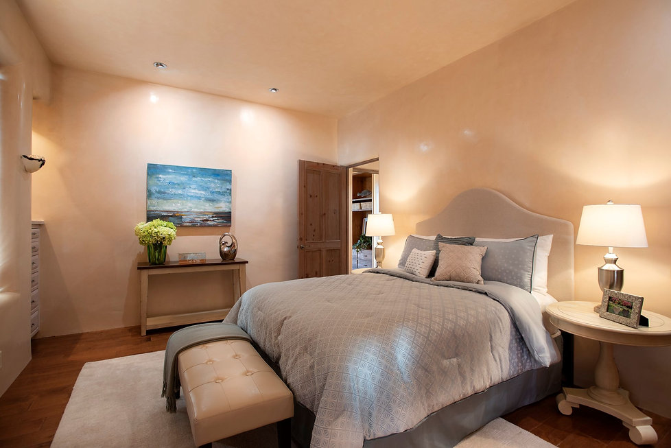 Master bedroom sanctuary with thoughtful lighting plan throughout.