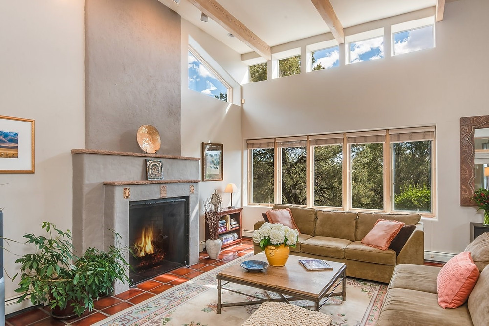 Example of a living room in an occupied Santa Fe home staged for an open house.