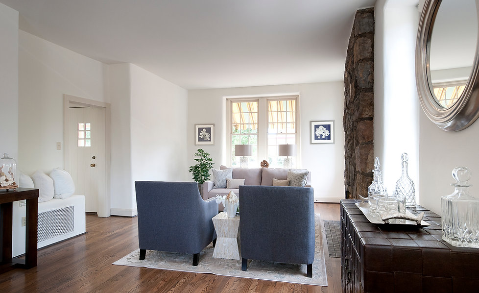 Fresh paint, glass and metal decor, modern blue upholstery, and leather sideboard upgrade historic home.
