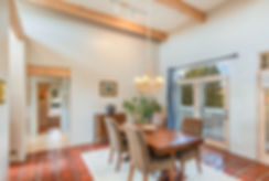 Occupied staging optimizes a home for real estate photos and open houses using owner furniture and decor.