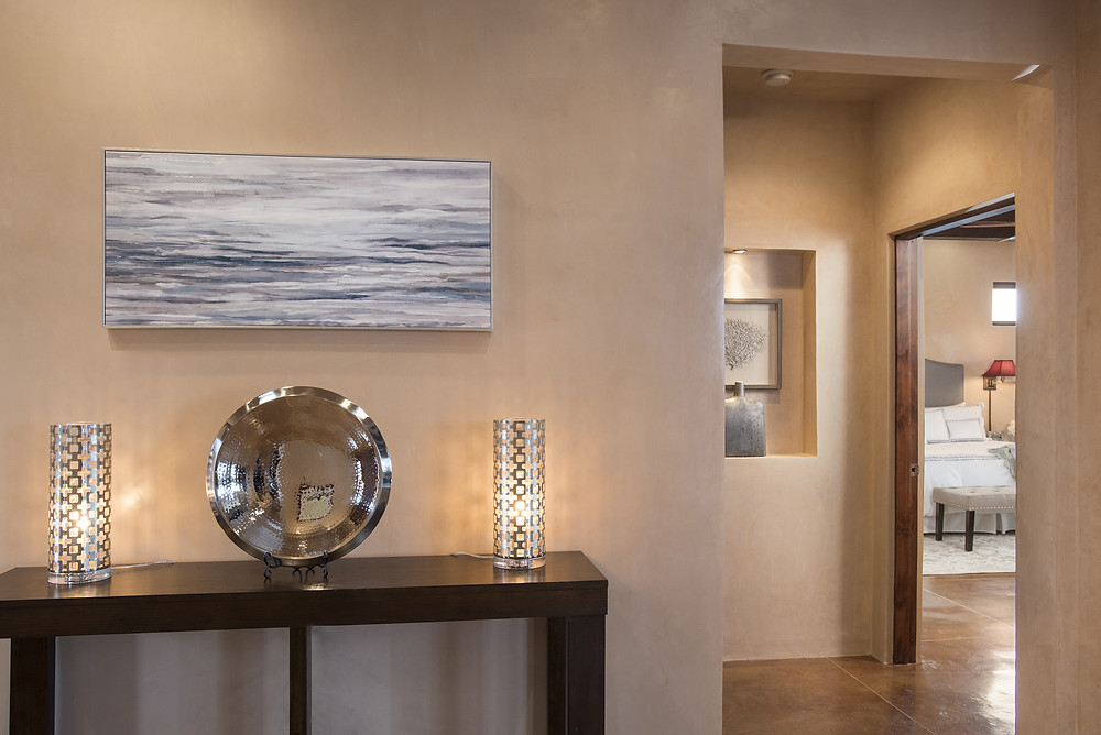 Modern decor in silvers and greys compliments warm diamond plaster walls in contemporary Santa Fe home.