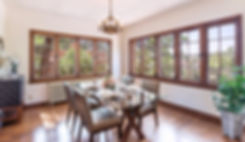 Vintage Santa Fe dining room featuring original divided light windows sensitively staged for open house.