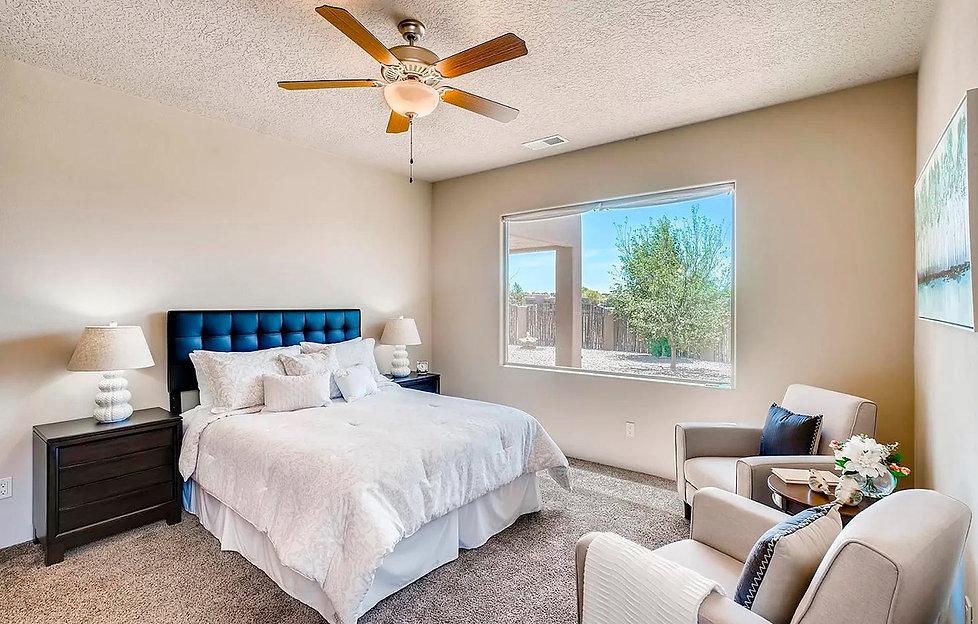 A calm and contemporary bedroom staged by interior designer Debbie DeMarais.