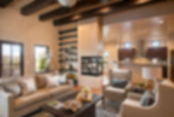 Southwest style with shining diamond plaster walls, dark vigas and home staging by Debbie DeMarais.
