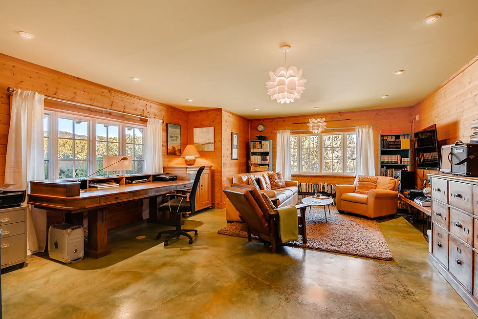 Stylish home office staged for real estate photographer by Debbie DeMarais in Santa Fe.