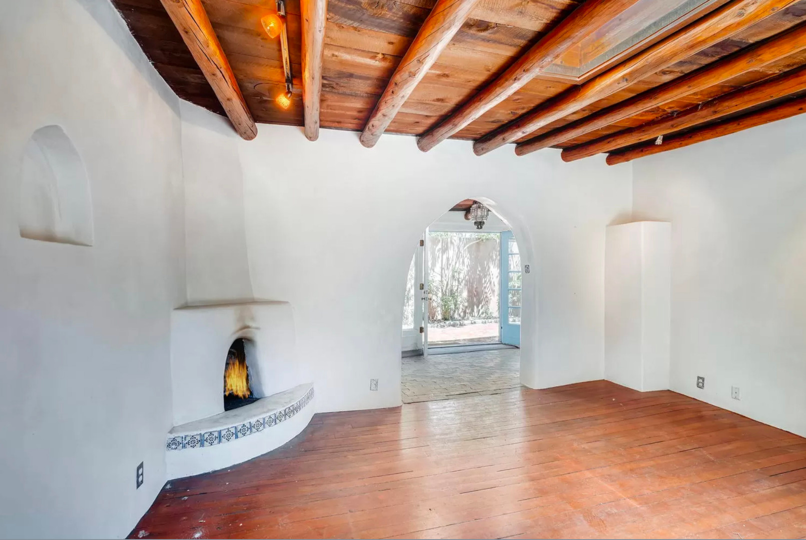 East Alameda | Kiva Fireplace, Vigas and Archway in Santa Fe Living Room