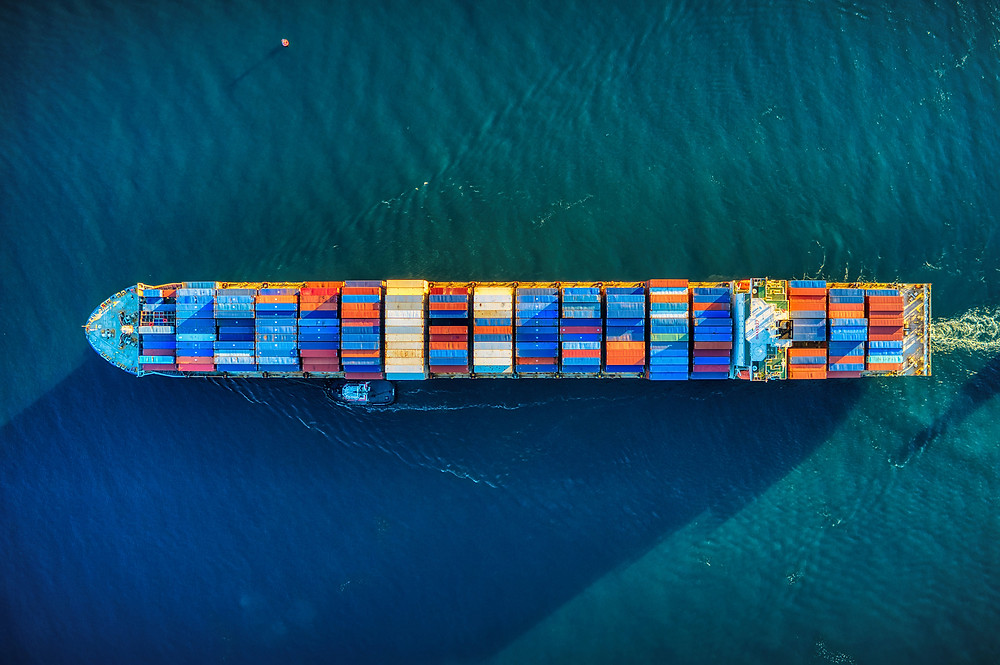 Ariel view of a cargo tanker ship with brightly colored cargo containers.