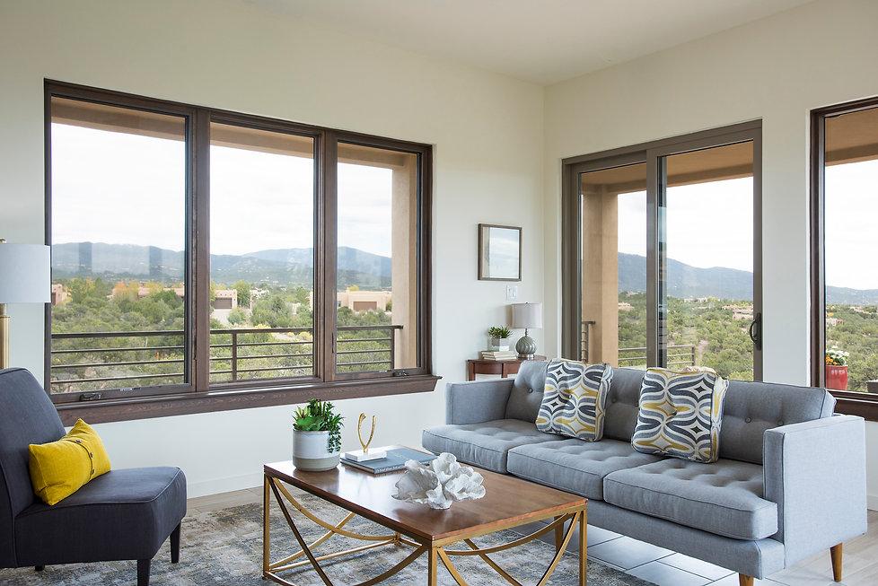 Spectacular Sangre de Cristo Mountain views wrap around stylish living room.