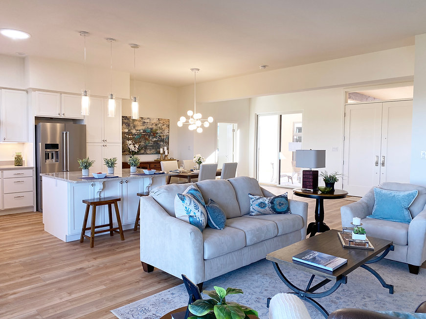 Open concept living area with dynamic light fixtures and thoughtful interior styling.