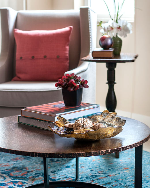 Detail of a stunning coffee table arrangement prepared for real estate photographer prior to open house.