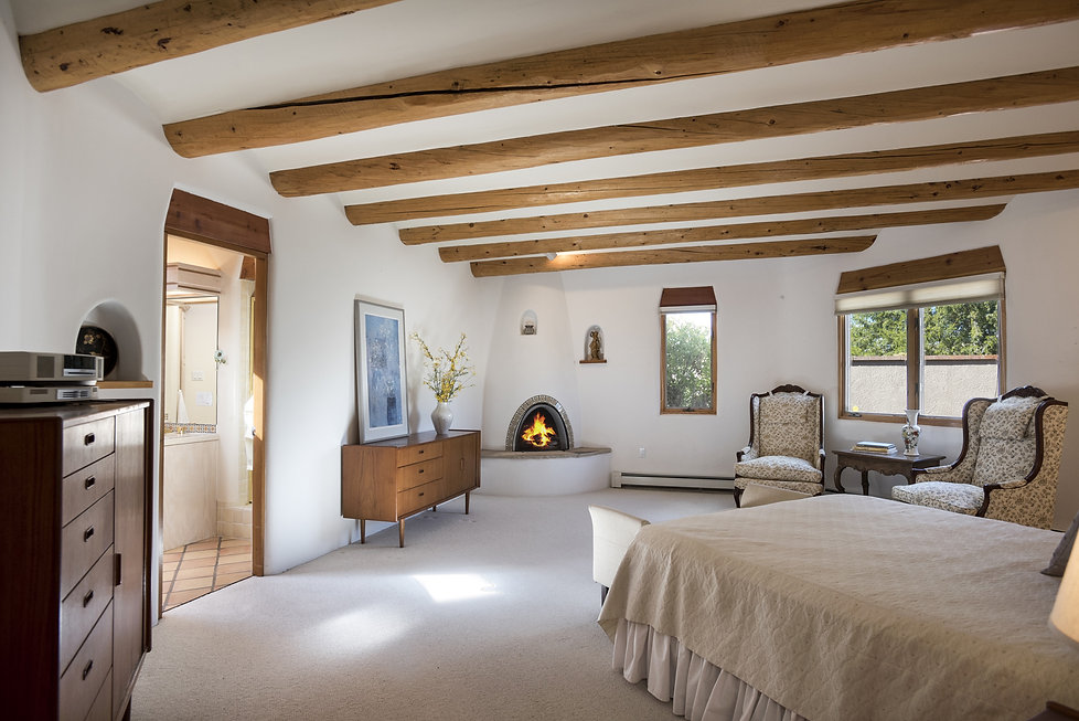 Santa Fe style bedroom after rearrangement of furnishings and declutter services.