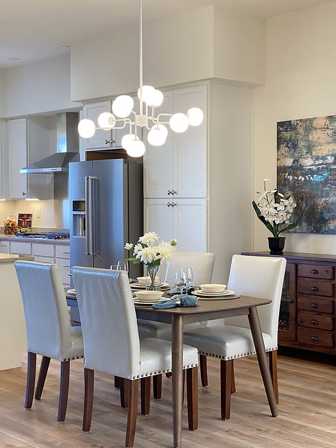 Staged dining area using furniture inspired by mid century modern styles.