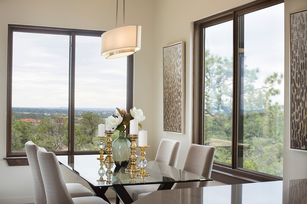 Smoked glass table top reflects light and colors in Santa Fe dining room.