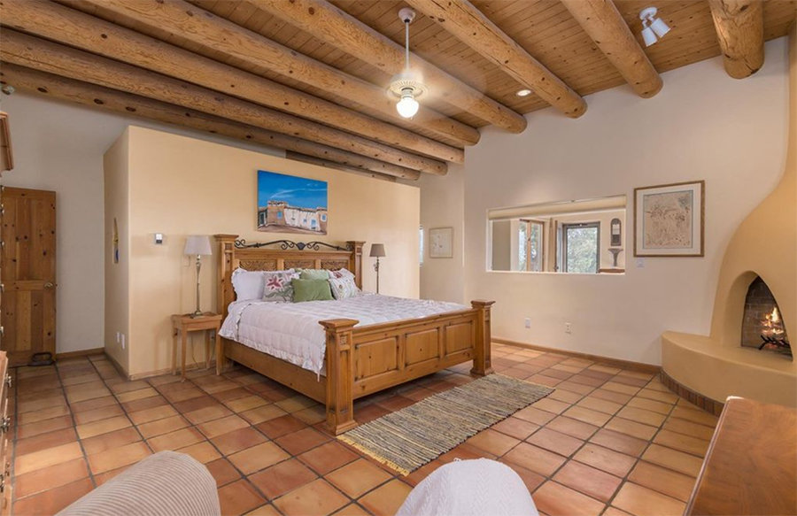 New Mexico bedroom staged using owners' furniture during time house was on market.