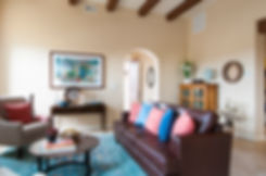 Southwest living room staged for open house with leather sofa, round decorative decor and complementary colors.