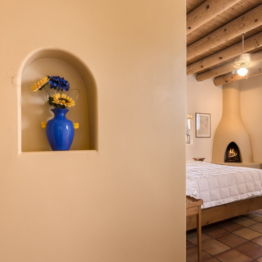 Vista Serena | Bedroom Nicho and Kiva Fireplace