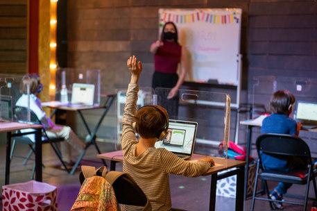 Ellie asks a question during a live lesson.
