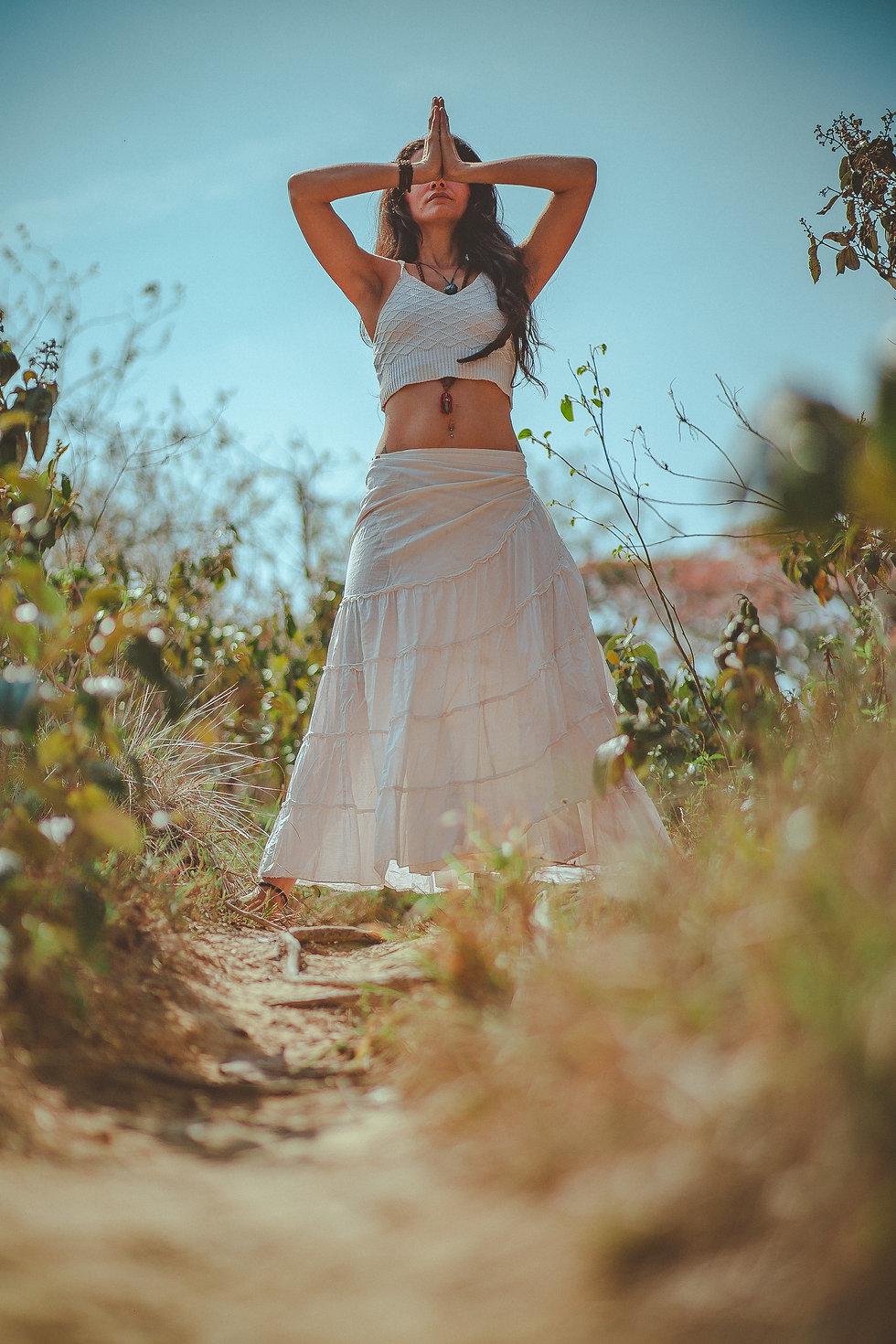 woman-in-white-tank-crop-top-on-grass-fi