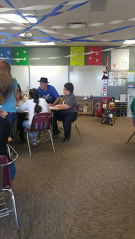 Fun Fact: Karl Egbert is also a cartoonist. Here he is representing ATEC as he draws with a local class.