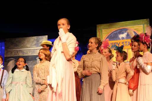 We love the local arts and the oportunities given to kids and adults. Here is a shot from the preformance of Music Man by the Evergreen Children's Coral