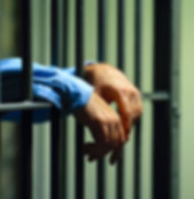 Arrested man in handcuffs with hands.jpg
