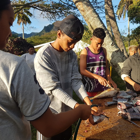 Cleaning and cutting up fish - Rongohiva